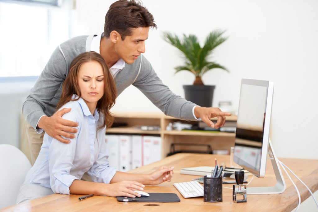 Workplace Harassment - Man Hugs Woman at Desk