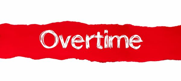 Overtime Written on Ripped Red Paper